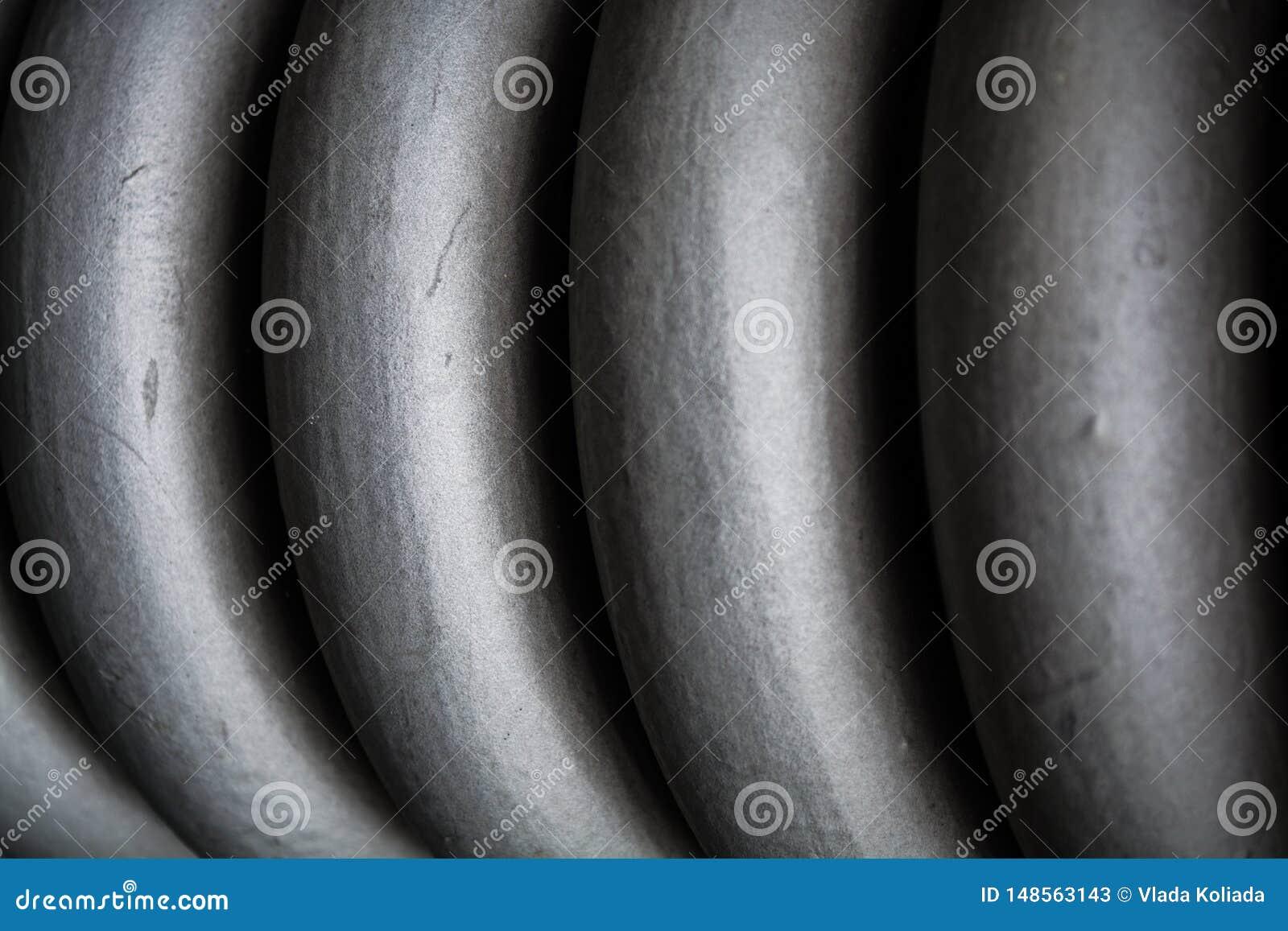 Zopf, graues starkes der Spirale vom Metall, f?r Wartung von Bauelementen Fr?hling Beschaffenheit oder ein Hintergrund in den mon