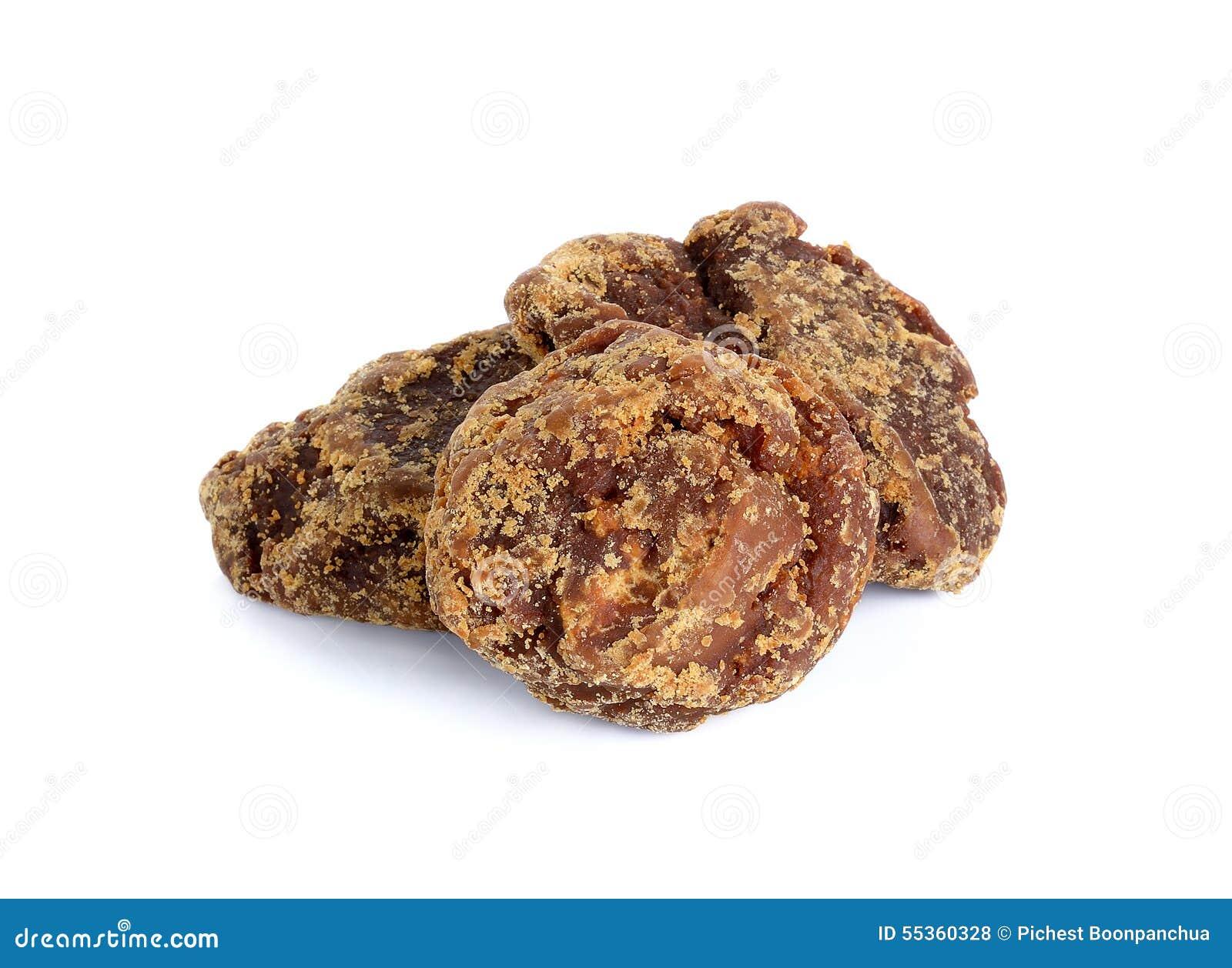 Zucchero di canna marrone organico isolato su fondo bianco