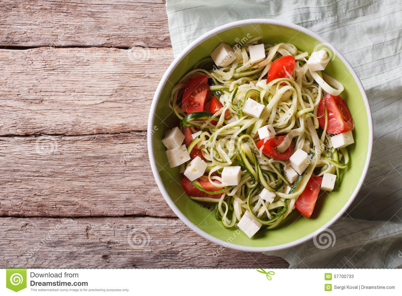 Zucchini pasta with feta cheese and tomatoes horizontal ...