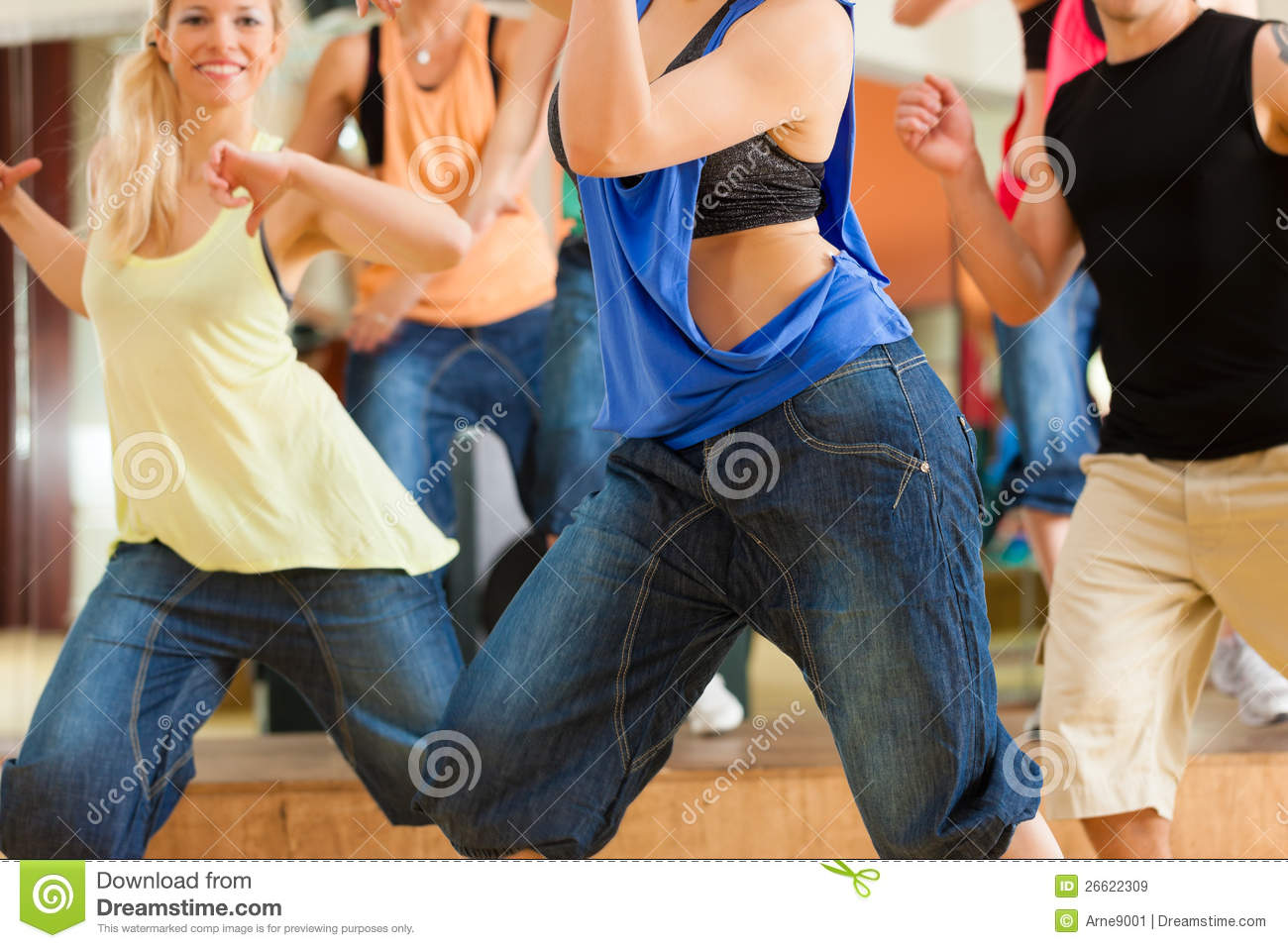 Zumba or Jazzdance - people dancing in studio