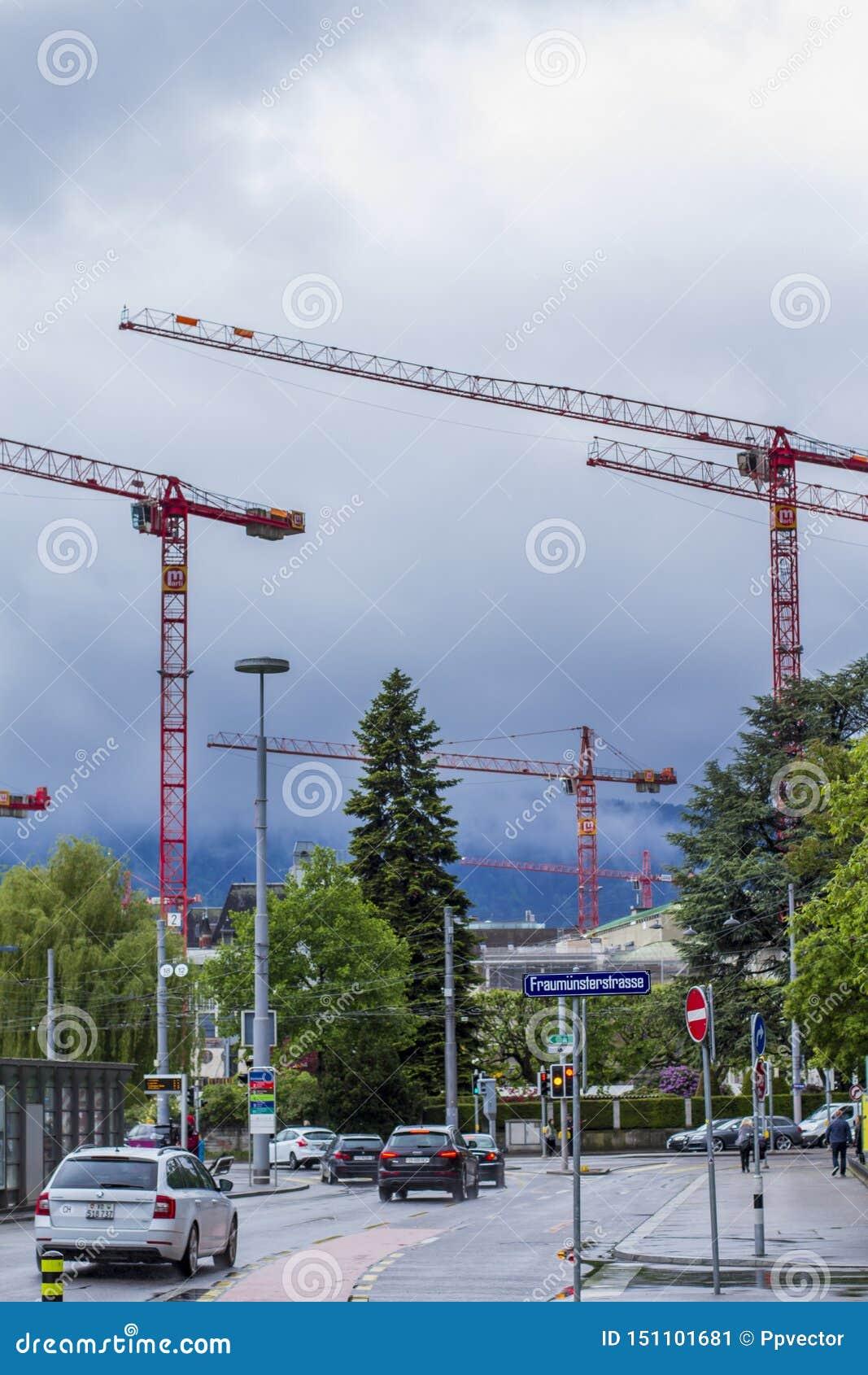 Zurich street. Construction cranes.