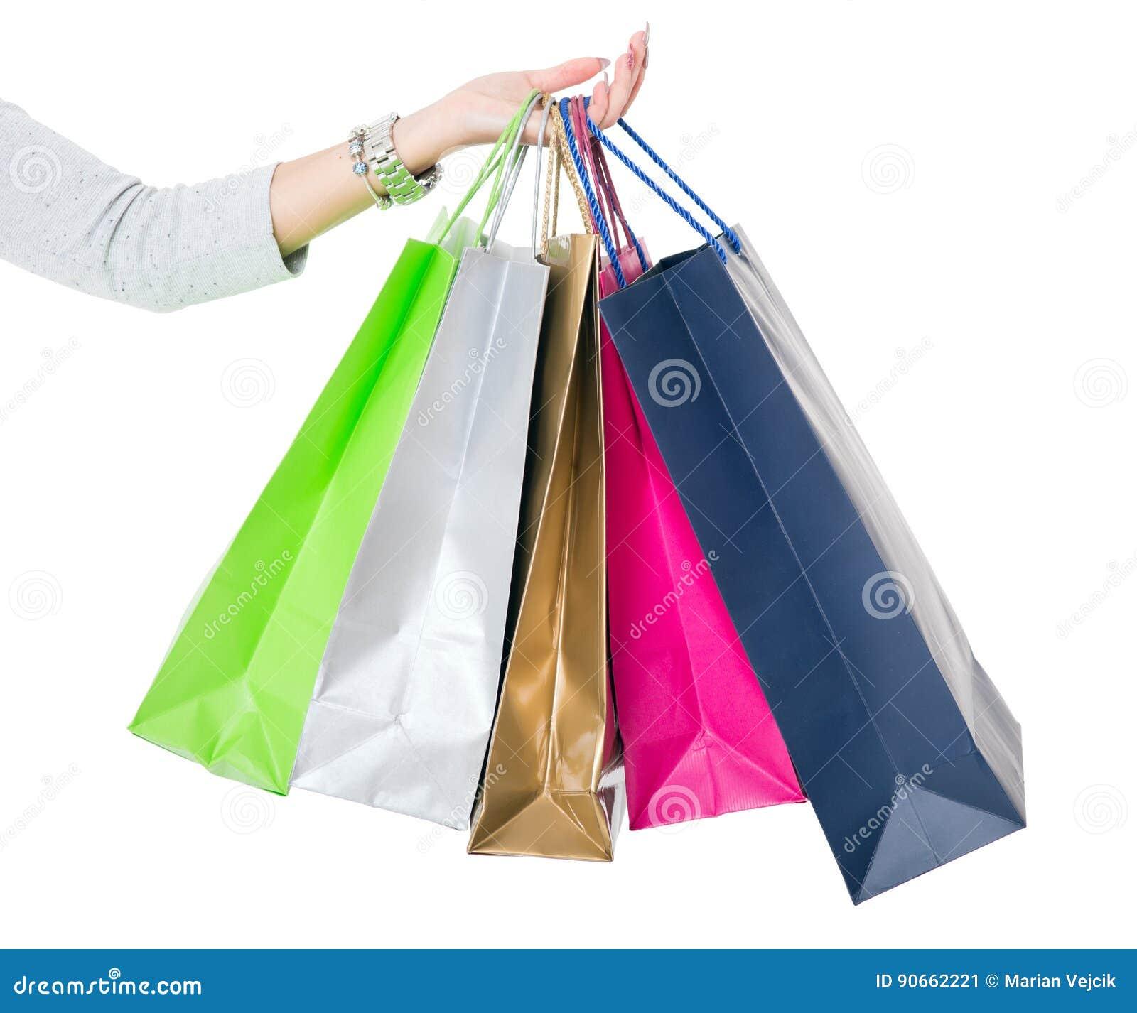 Zusammensetzung #2 Weibliche Hand, die bunte Einkaufstaschen auf Weiß hält