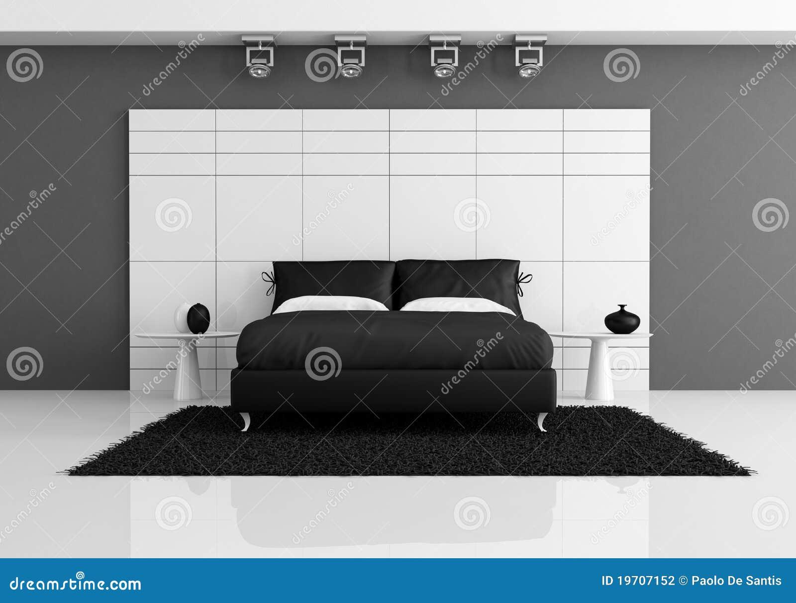 Zwart-witte slaapkamer met tweepersoonsbed tegen wit paneel dat ...